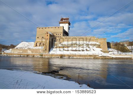 The old Herman's castle on the Narva river, cloud march afternoon. Estonia