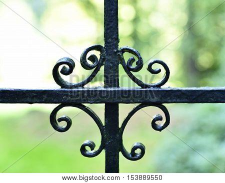 Wrought iron fence. decortative fence, ornate boundary background.