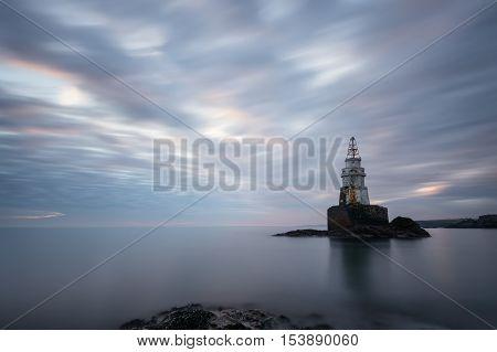 Winter cloudy sunrise at Ahtopol lighthouse, Bulgaria
