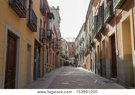View narrow old street near market square of medieval Avila town. Castile and Leon Spain