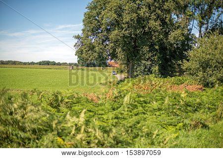 Silver Car Driving In Rural Dutch Landscape. Winterswijk. Achterhoek. Gelderland. The Netherlands.