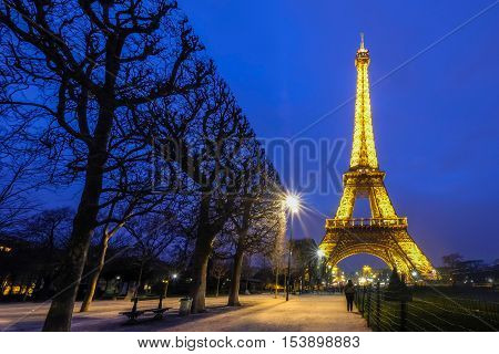PARIS - MARCH 15, 2015 : The beautiful Eiffel Tower brightly illuminated at dusk on MARCH 15, 2015 in Paris. The Eiffel tower is the most famous landmark and  most visited monument in Paris, France.