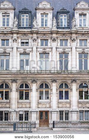 The front (facade) of a vintage building in Paris, France - Renaissance architecture