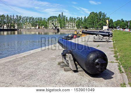 Kronstadt Russia - 10 July 2016: Italian pond and a smoothbore cannon that once stood on the arms of castles and forts
