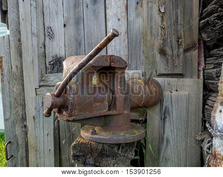 Old rusty table vises for handwork on metal and wood