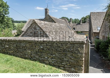 Typical limestone cottages in Upper Slaughter Cotswolds a sunny day of summer.