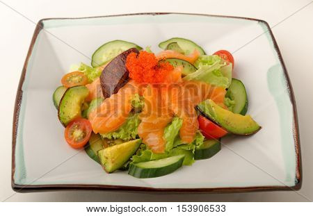 Raw salmon salad with fish roe an entree from a Japanese restaurant menu.