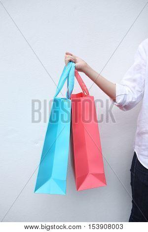 Woman holding shopping bag on white background