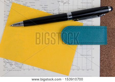 World Atlas Business Diary Book With Yellow Paper Note. Open Business Diary Map Book With World Map