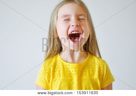 Little funny toddler girl screaming at home