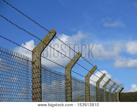Sturdy concrete and wire fencing at animal farm on Isle of Portland Dorset UK