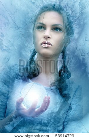 Girl Holds A Glass Glowing Sphere