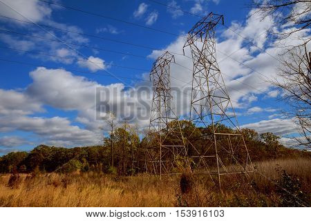 Power Line Against The Blue Bright Sky