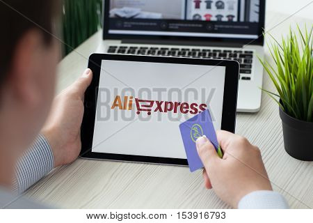 Alushta Russia - September 3 2016: Man holding a iPad Pro with Internet shopping service Aliexpress on the screen. iPad Pro was created and developed by the Apple inc.
