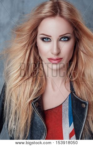 Portrait of beautiful blonde girl with sumptuous long hair and blue eyes