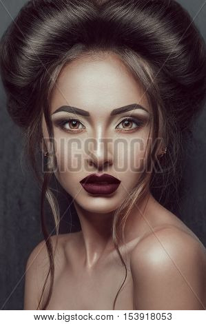 Portrait of Beautiful gothic girl with awesome makeup and hairstyle
