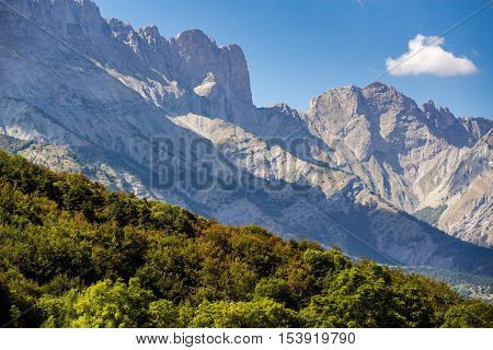 Faraut mountain peaks (Breche de Faraut and Pic de Chabournasse) in Champsaur and tree line in early Fall. Hautes Alpes, Southern Alps, France