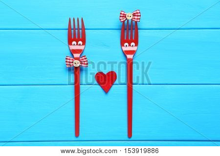 Red Plastic Forks With Googly Eyes On Blue Wooden Table