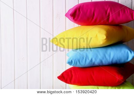 Colorful Pillows On A White Wall Paneling Background