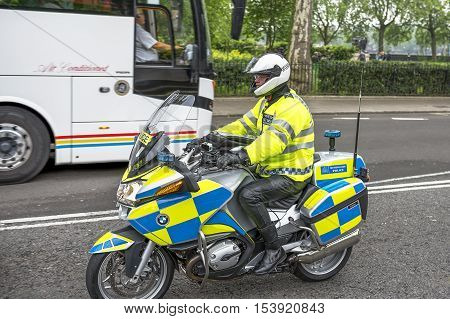 London, the UK-May 2016: Police on bike at the city streets