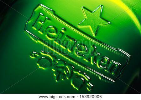 Brest Belarus - October 15 2016: Logo of the brand Heineken on the green beer bottle. Macro shot