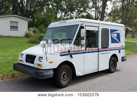 JACKSONVILLE, FL - OCTOBER 28, 2016: A United States Postal Service, USPS, collection and delivery van in a neighborhood. The USPS is responsible for providing postal service in the United States.