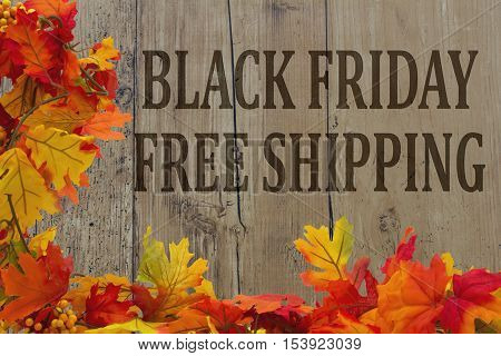 Black Friday Shopping Free Shipping Autumn Leaves with grunge wood with text Black Friday Free Shipping