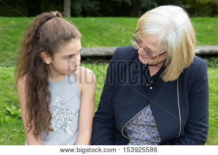 Cheerful Grand Mother Talking With A Teenager