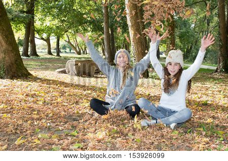 Young pretty girl arms up in the autum