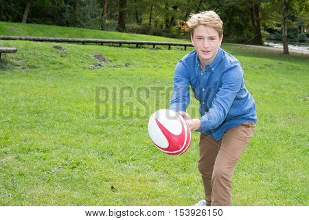 Happy Boy, In The Park Playing With A Rugby Ball