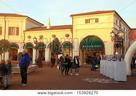 NOVENTA DI PIAVE, ITALY - JANUARY 6, 2016: People in the McArthurGlen Designer Outlet in Noventa di Piave near Venice, Italy. Outlet was designed as a luxury shopping destination.