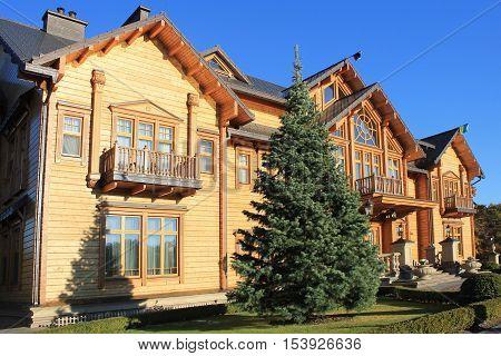 KYIV, UKRAINE - OCTOBER 29, 2015: Wooden Honka house in Mezhyhirya former private residence of ex-president Viktor Yanukovich now open to public Kyiv region Ukraine.