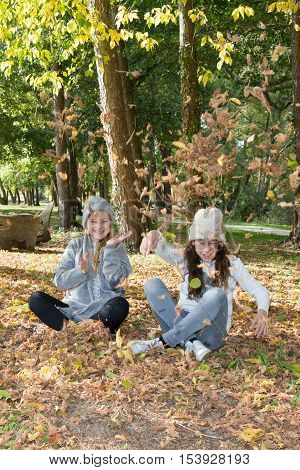 Girls Best Friends Sitting On The Field In The Autum