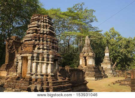 On the ruins of the ancient temple Wat Chedi Chet Thaye. Si-Satchanalai, Thailand