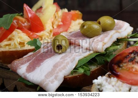 bruschetta with ham olives and arugula, bruschetta with ham olives and arugula