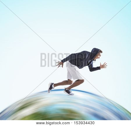 African American guy running on huge globe surface. Concept of the fastest man on Earth. Mock up.