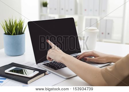 Woman Pointing At Blank Laptop Screen
