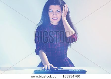 Confused Young Girl And A Keyboard