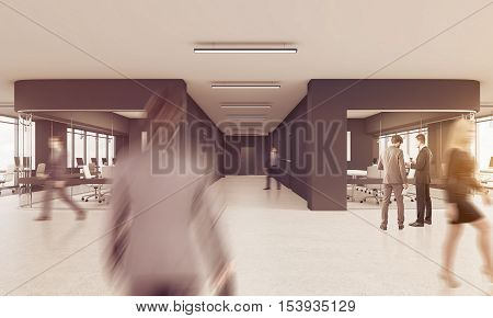 People walking in busy office with black and glass walls and concrete floor. Concept of working together. 3d rendering. Toned image
