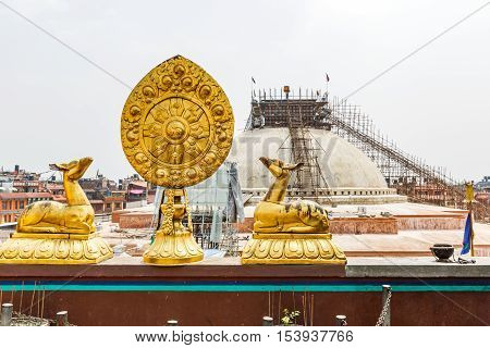 Golden deers and the wheel of Dharma sacred buddhist symbols