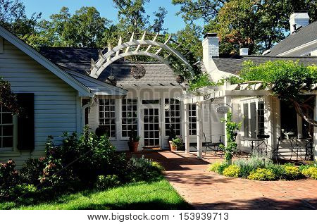 Pittsboro North Carolina - October 28 2016: Gardens and trellis terrace at the Five star luxury Fearrington House Hotel at Fearrington Village