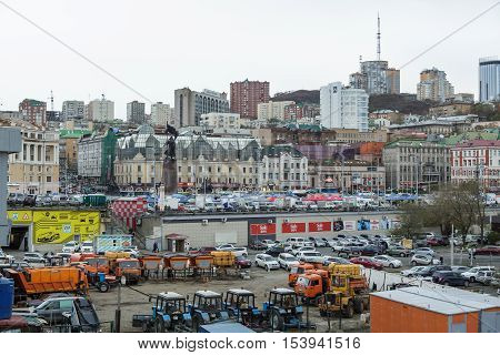 Vladivostok Russia - October 21th 2016: Vladivostok the market on a central square with a monument to Fighters for the power of Councils in the Far East and adjoining territory with road technics.