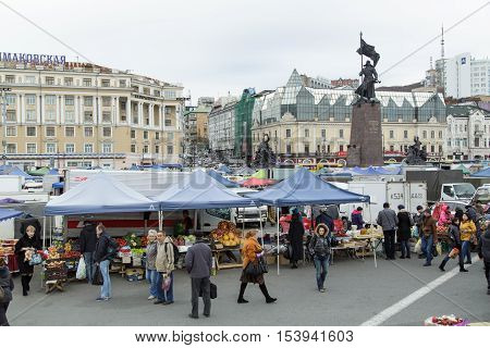 Vladivostok Russia - October 21th 2016: Vladivostok trading numbers on a central square of Vladivostok with a monument to Fighters for the power of Councils in the Far East.