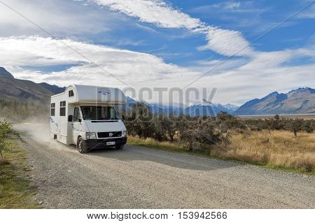 Canterbury New Zealand - February 2016: Motorhome driving on gravel road at Glentanner Park Centre Aoraki / Mount Cook National Park