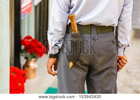 Gurkha officer with gurkha knife attached to the back of his belt
