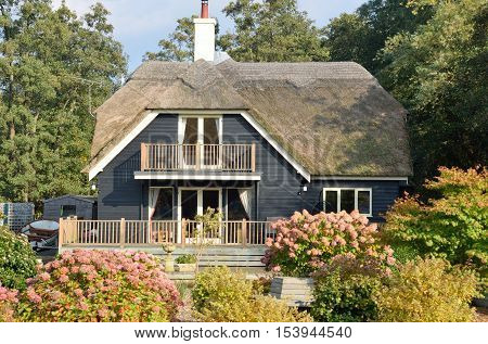 Large English Thatched cottage with black frontage