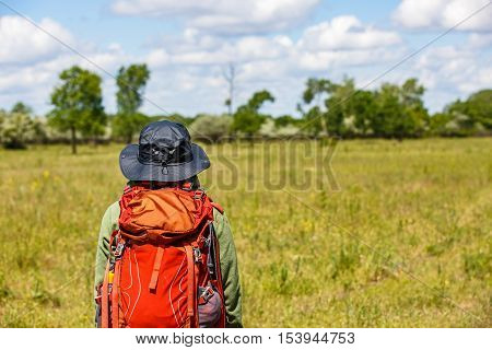 Photo of young trekker woman with rucksack in Letea Forest