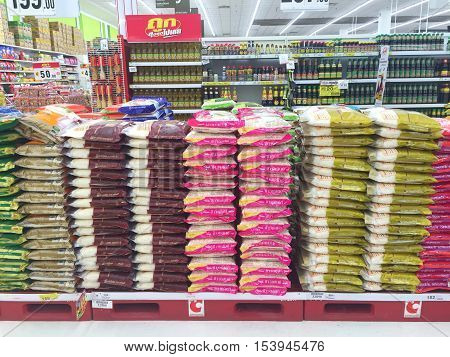 CHIANG RAI THAILAND - OCTOBER 28 : various brand of pile of packed rice for sale on supermarket stand or shelf in Big C Supercenter on October 28 2016 in Chiang rai Thailand.