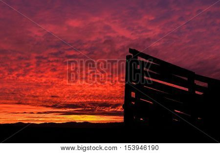 Stockyard loading ramp with a wonderful sunrise in the background.