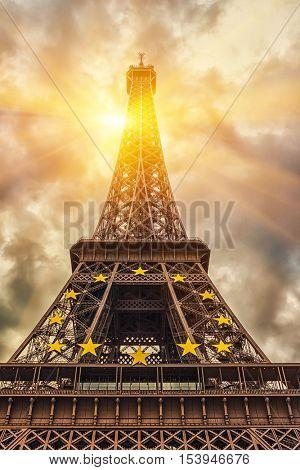 The Eiffel tower under sun light / Sunrise In Paris